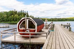 Free Summer Lake Nature Landscape View Of A Traditional Scandinavian Water Floating Red Wooden Sauna Spa Next To A Jetty. Stock Image - 155317191