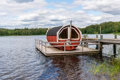 Free Summer Lake Nature Landscape View Of A Traditional Scandinavian Water Floating Red Wooden Sauna Spa Next To A Jetty. Royalty Free Stock Photography - 155317227