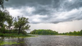 Summer lake and rain clouds, time-lapse stock footage