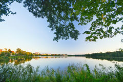 Summer lake at sunset Stock Photos