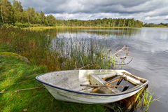 Summer lake in Sweden with boat. Swedish lake with boats in summer time Royalty Free Stock Photo