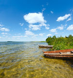 Summer lake view with wooden boats. Royalty Free Stock Photos