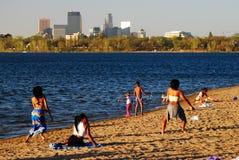 Summer at the lakeshore. Young beachgoers enjoy a summer Day along the Shore of Lake Calhoun stock photos