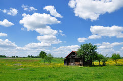 Summer landscape with abandoned farm house Royalty Free Stock Photo