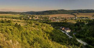 Summer landscape - agrotourism. Summer village surrounded with green fields, mountains, forest. Village - Dobra Voda stock photography