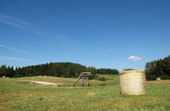 Summer landscape with bale of straw Stock Image