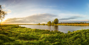 Summer landscape on the banks of the green river at sunset, Russia, Stock Photo