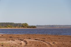 Summer landscape on the banks of the river water sand and clear sky in the city of federation province of entre rios argentina. Summer landscape on the banks of royalty free stock photo