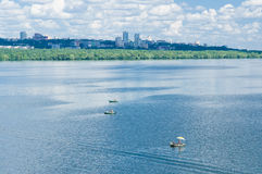 Summer landscape with big river Dnepr. And skyline of Dnepropetrovsk city, Ukraine royalty free stock photo