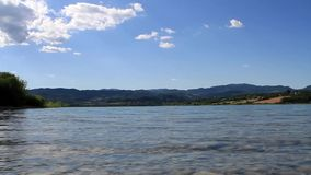 Summer landscape on Bilancino lake, Blue sky and clouds in Tuscany stock video