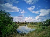 Summer landscape. River, blue sky, cloud. royalty free stock photo