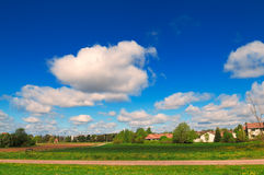 Summer landscape of blue sky, white clouds and green field. Summer landscape with the blue sky, white clouds and green field stock photography