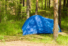 Summer landscape with blue tourist tent Stock Photography