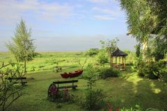 Summer landscape with boat, benches and gazebo Stock Photos