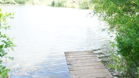 Summer landscape, bridge on the shore of the pond royalty free stock photo