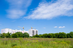 Summer landscape with a building construction site Stock Images