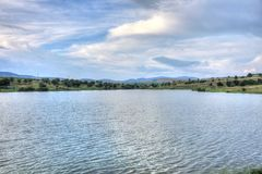 Summer landscape in Bulgarian countryside. Summer landscape with a picturesque lake and fluffy clouds somewhere in Bulgarian countryside Stock Photos