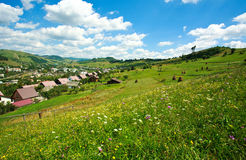 Summer landscape in the Carpathian villages under a blue sky Royalty Free Stock Image