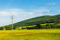 Summer landscape with clear blue sky and hill Stock Photos
