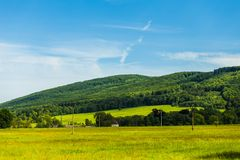 Summer landscape with clear blue sky and hill Stock Photo