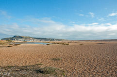 Summer landscape and clouds on Chesil beach in Dorset, UK. Royalty Free Stock Photo