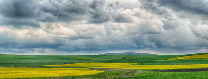 Landscape with colourful fields and stormy clouds Stock Photo