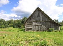 Summer landscape in the countryside in Latvia, East Europe. Old wooden shed. Summer landscape in the countryside in Latvia, East Europe. Old wooden shed royalty free stock images