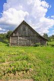 Summer landscape in the countryside in Latvia, East Europe. Old wooden shed stock image
