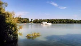 Summer landscape on Danube Delta Romania. Summer landscape from the Danube Delta. Tourist Boat on Danube Delta stock photo