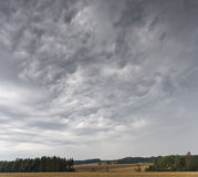 Summer landscape with dramatic cloudy sky Royalty Free Stock Photography