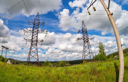 Summer landscape with electric power lines. On a blue sky background Royalty Free Stock Photography