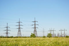 Summer landscape with electricity pylons Stock Photos