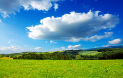 Summer landscape with field and clouds. stock photos