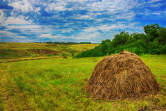Summer landscape on the field worth stack hay bale Stock Photo