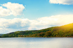 Summer landscape with forest lake. And blue sky Royalty Free Stock Image