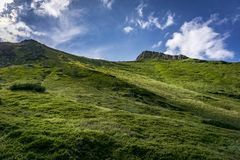 Summer landscape of green hills against the blue sky. Belianske. Tatry Mountains Slovakia royalty free stock photography