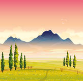 Summer landscape with green meadow and mountains. Morning summer landscape with green flowering meadow, cypress trees and mountains with fog on a pink sky Royalty Free Stock Photography