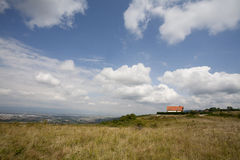 Summer landscape with house. And clouds stock images