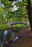 Summer landscape with lake and bridge in Gatchina park, Royalty Free Stock Photo