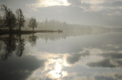 Summer landscape, lake and jetty in fog Stock Photography