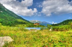 Summer landscape. Lake and mountain chalet. Stock Photography