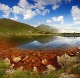 Summer landscape with lake in mountains Stock Image