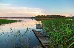 Summer landscape with lake and wooden bridge Stock Image