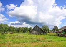 Summer landscape in Latvia, East Europe. Old wooden shed. Building royalty free stock photography