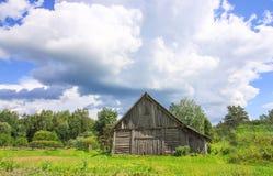 Summer landscape in Latvia, East Europe. Old wooden shed building. Summer landscape in Latvia, East Europe. Old wooden shed building royalty free stock images