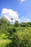 Summer landscape in Latvia, East Europe. Stork nest on the utility pole. Summer landscape in Latvia, East Europe. Stork nest on the utility pole stock photos