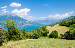 Summer landscape with mountain lake Stock Photos
