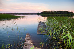 Summer landscape with old footbridge on the lake Stock Photo