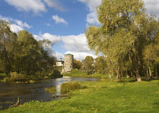Summer landscape with old tower. And church in Pskov Royalty Free Stock Photo