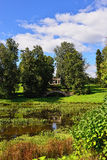 Summer landscape of the Pavlovsk garden, Apollo Colonnade. Summer landscape of the Pavlovsk garden, Russia. View from the pool to the Apollo Colonnade pavilion Royalty Free Stock Image